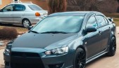 Front lip central insert between fangs for Mitsubishi Lancer X 2007 - 2012 V2