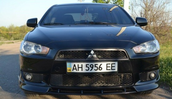 Lip spoiler for Mitsubishi Lancer X 07-12 Central Insert between fangs bumper